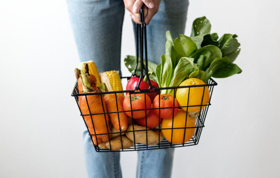 Carrying a basket of vegetables